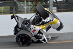 The car driven by Josef Newgarden slides down the track after hitting the wall in the first turn and going airborne during practice for the Indianapolis 500 auto race at Indianapolis Motor Speedway in Indianapolis, Thursday, May 14, 2015. (AP Photo/Marty Seppala) ORG XMIT: NAA118